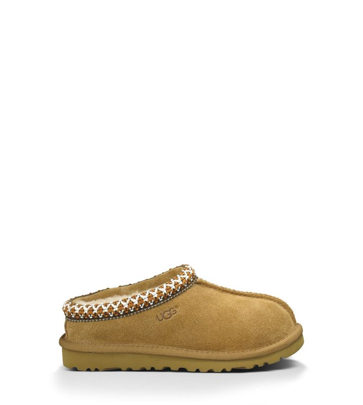 UGG® Tasman for Kids - The Tasman is composed of rich suede fully lined in luxurious sheepskin, featuring our heritage Tasman woven braid.  Stylish Children's House Slippers at the official UGG® site - UGG.com