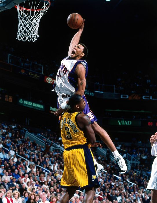 "The ""Matrix"" Shawn Marion explodes for a dunk in the Phoenix Suns' white home uniform."