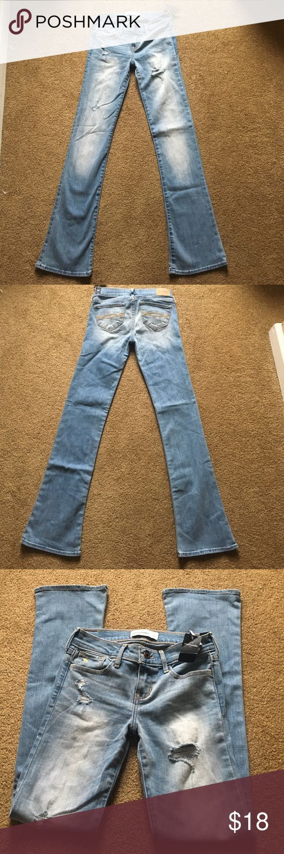 Abercrombie Kids Girls Bootcut Light Wash Jeans 12 NWT. Light wash Bootcut with distressing. Approximate measurements (may be slightly off) waist 12 in, Rise 7 in, hips 14 in, inseam 27.5 in and leg opening 7 in. abercrombie kids Bottoms Jeans