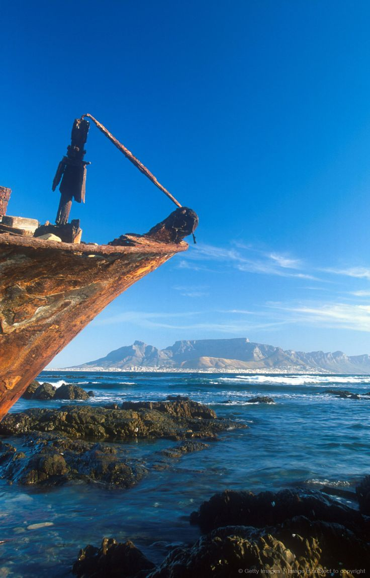 Shipwreck on Robben Island with Table Reason Mountain and Cape Town in background, Western Cape Province, South Africa