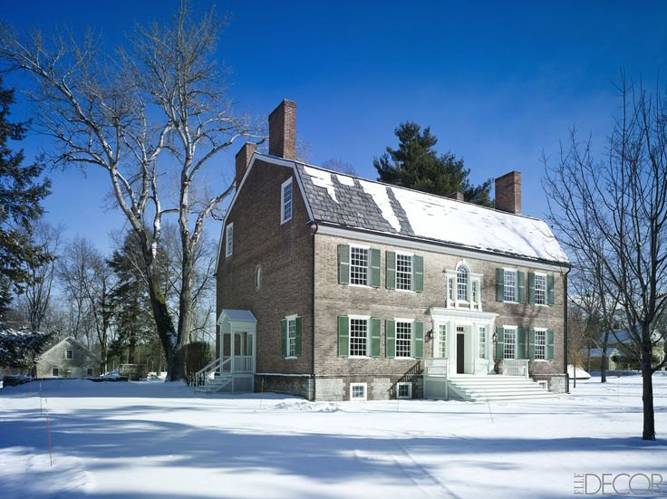 228-year-old Ludlow Homestead, in Claverack, New York was built in 1786 with bricks made on-site, and the shutters are painted in Farrow & Ball's Calke Green; the structure to the left, originally the summer kitchen, is now used as a potting shed. Peter Spears and Brian Swardstrom transformed the home   - ELLEDecor.com