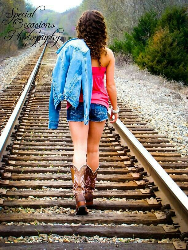 Country girl from her cowgirl boots to her down home roots cute picture idea for senior pictures