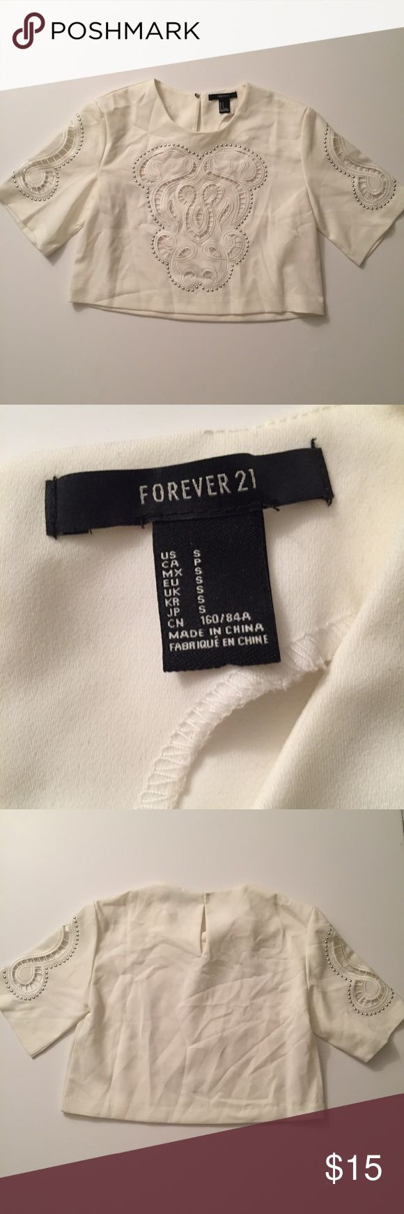 Like New forever 21 boxy crop-S Like new only worn once or twice for pics.  Size small white crop embellished Tags: mura, tiger mist, showpo, sabo skirt, white fox, missguided, h and m, hello Molly, Stelly, hot Miami styles, fashion nova, princess Polly, verge girl, pop cherry, forever 21, Nordstrom, revolve Forever 21 Tops Crop Tops
