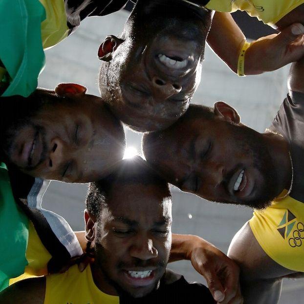 Asafa #Powell, Yohan #Blake and Nickel #Ashmeade e Usain #Bolt, dopo aver vinto l'oro per la Giamaica nella 4x100 maschile