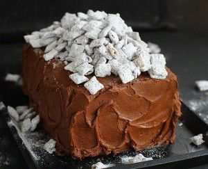 Puppy Chow. Monkey Munch.Muddy Buddy Mix. Crazy fun names. Crazy yum taste. Mix that with a crazy baker and you justknow I just had to make it into a cake.  The hardest part about this cake was deciding how to make it. Do I make a layer of peanut butter? Should the outside be