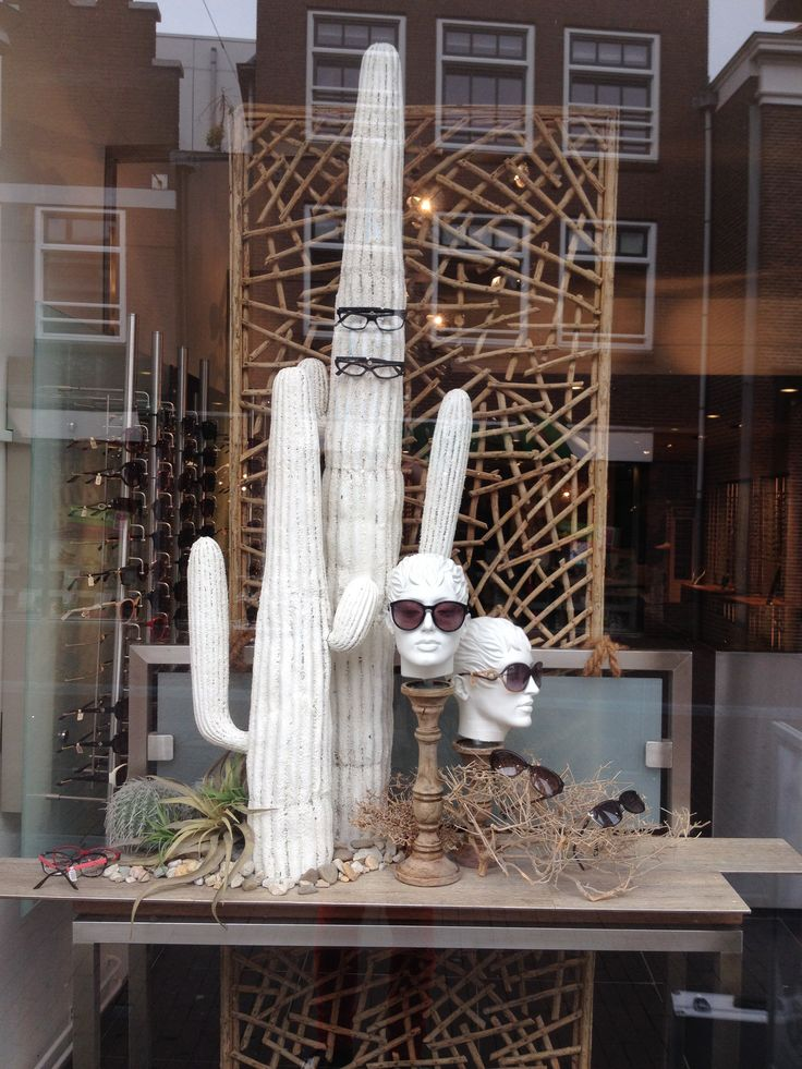 Summer window display at an optician. Styled by Rich Art Design.