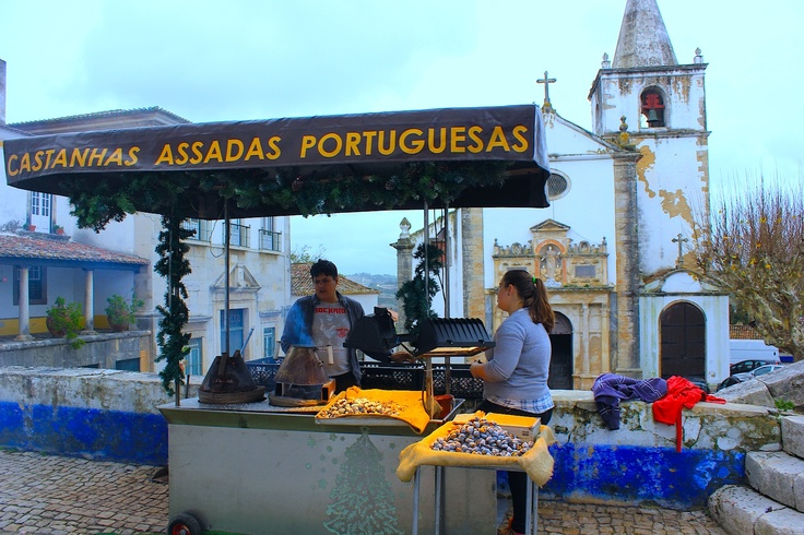 Dec 17, 2012. The Christmas spirit is all around in Portugal. These sellers offer traditional Portuguese nuts to the visitors in Obidos.