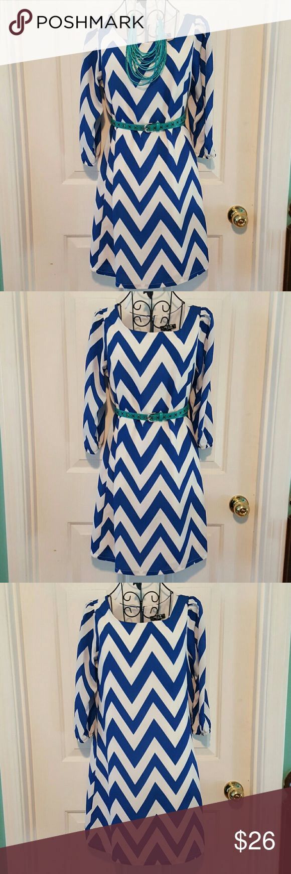 Blue and white chevron tunic/dress So pretty and versatile- plays well with accessories!  Great for the wedding guest or businesswoman. Fully lined. 3/4 length sleeves. Belt/necklace not included. Please note, this fits more like a 10-12. Sequin Hearts Dresses Midi