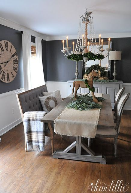 A tufted bench from @homegoods adds an unexpected seating option to this dark gray dining room and festive pillows, a wool throw and a vintage style wooden horse add fun Christmas touches. (sponsored pin)