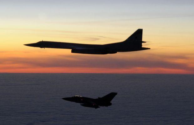 Russian Tupolev Tu-160 Blackjack bomber being intercepted by RAF Panavia Tornado.
