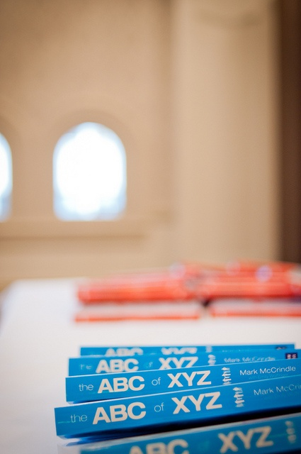 Books. The ABC of XYZ. In the background, Word Up. By Mark McCrindle.