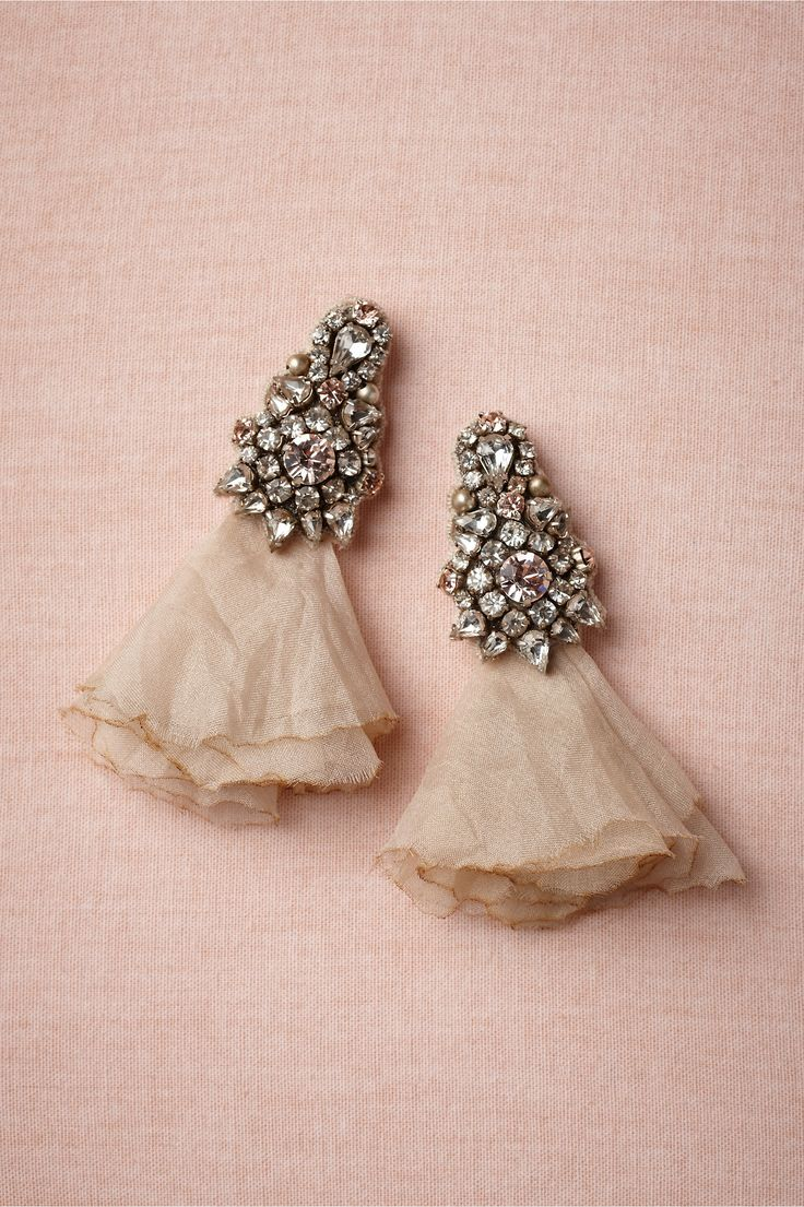 These delicate yet bold earrings would look so pretty with a loose chignon. From BHLDN