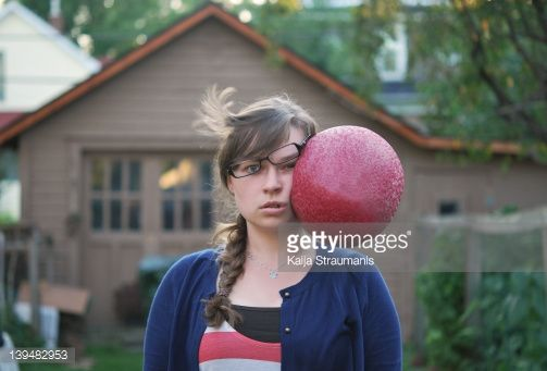 Stock Photo : Female hit in face with ball