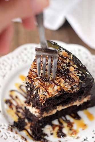 Sinful Samoa Cake. Don't wait all year for your favorite girl scout cookie, make this cake to satisfy your craving. Chocolate cake with a coconut caramel cream cheese and topped with more chocolate and caramel with toasted coconut.