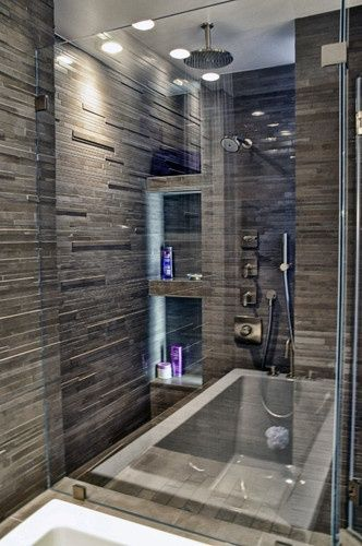 tile; shower head from ceiling; sauna; wise use of space w/ soaking tub and shower against same wall.