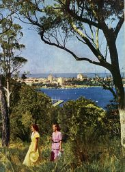 TWA-0046055 © WestPix Western Mail colour - Pic taken from Christmas Western Mail 1949 - 50 -  Bushland Frames a City View - Summer sunshine highlights the city in this view from Mt. Eliza, where the natural bushland of King's Park slopes steeply to the Swan River. Beyond the city is the regular outline of the distant Darling Range. Down to the water: A view through Kings Park bu