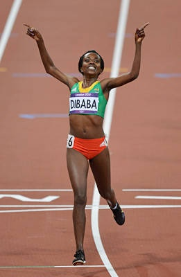 Ethiopia's Tirunesh Dibaba reacts after winning gold in the women's 10,000-meter final