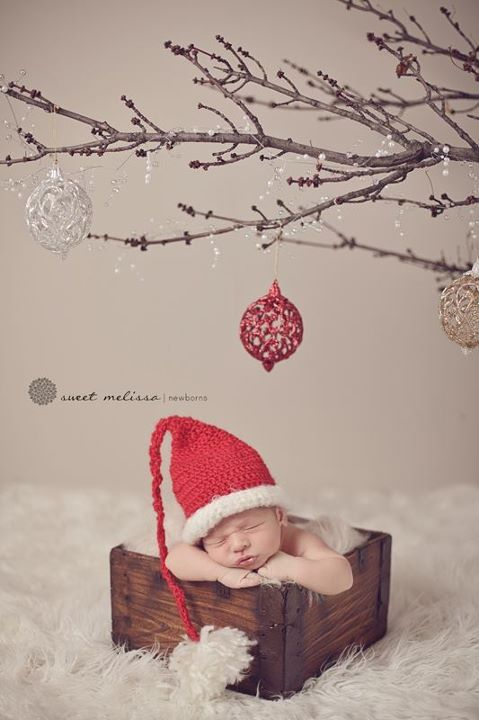 I don't like the way the baby is posed (looks uncomfortable) but I love that branch with the ornaments.