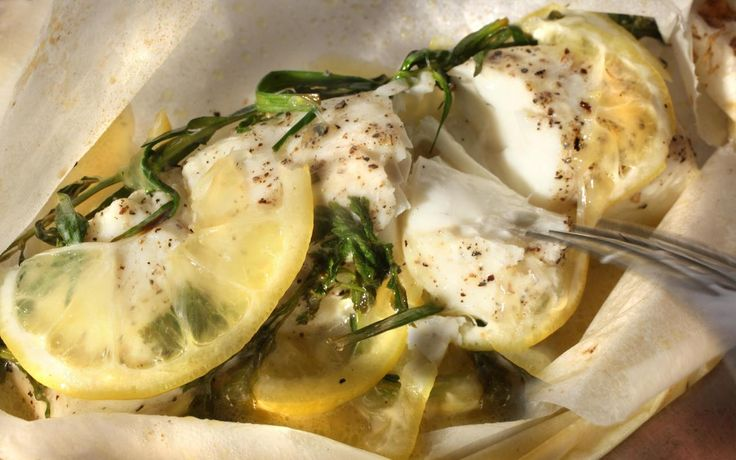 White fish steamed in a paper packet with lemon, olive oil, and white wine.
