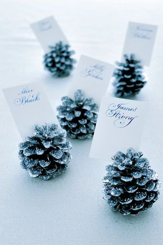 Guide guests to their seats with pretty glitter pine cones. Spray paint