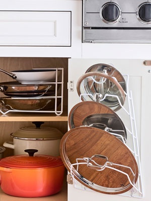 use a lid rack to keep pots and pans lids organized image via kitchen cabinet