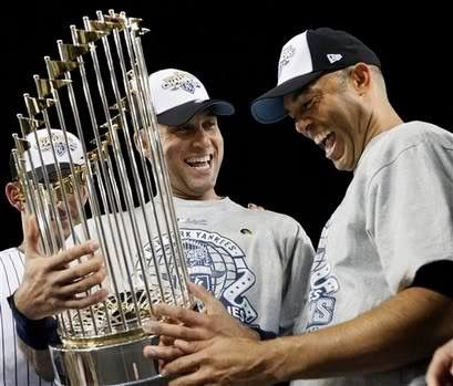 Jeter and Mariano Rivera look at the 2009 championship trophy after winning  World Series on Nov. 2009 against the Philadelphia Phillies, in NY.