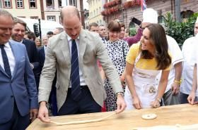 Prince William and Kate met one of the stars of their favourite TV show Game of Thrones - and tried to persuade him to reveal what happens next. The royal couple chatted to German actor Tom Wlaschiha, who plays Jaqen H'ghar in the cult show, at an event in Berlin on Thursday night. Prince William and his family are heading home today after their successful charm offensive to Germany and Poland.
