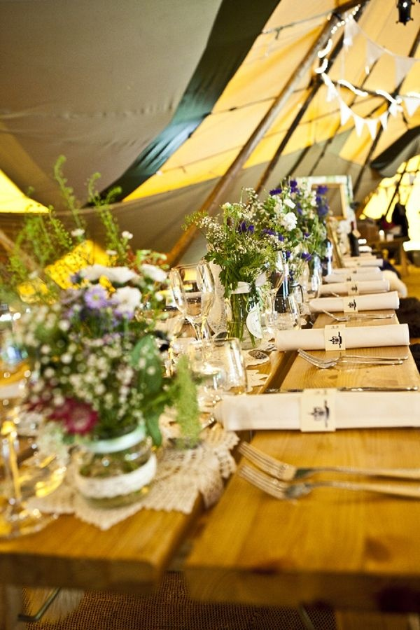 Tipi, long tables, jam jars of flowers... The perfect combo for a relaxed festival style wedding. All very rustic and homemade