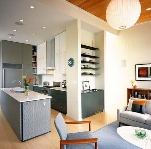 Kitchen:Modern Kitchen Minimalist Kitchen White Counter Top Ceramic Tile Laminate Flooring Blue Carpet Arm Chairs Oval Desk Globe Pendant Wh...