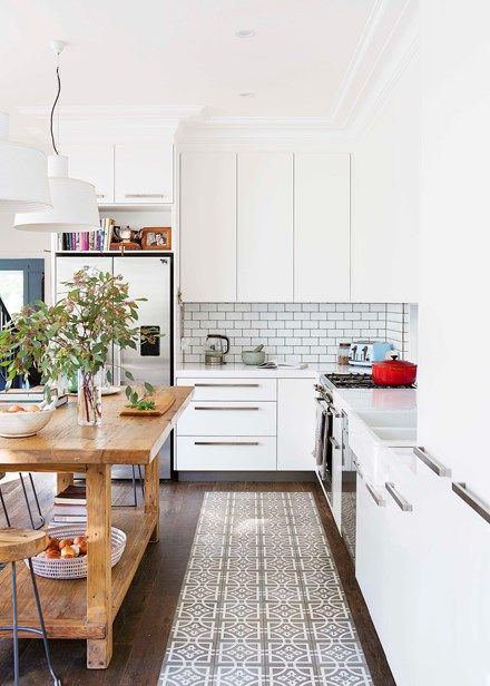 The home's Federation heritage was integral to the design and is reflected in the high ceilings, timber floors and vintage-look tiles of the new space | Home Beautiful Magazine Australia