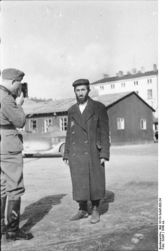 Litzmannstadt ghetto, Poland 1940: A propaganda SS photographer snaps a portrait of ghetto inhabitant.