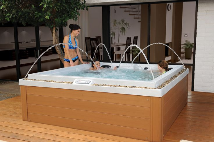 With a deck jet in each corner, this hot tub's special features create beautiful fountains of water. MAAX Spas