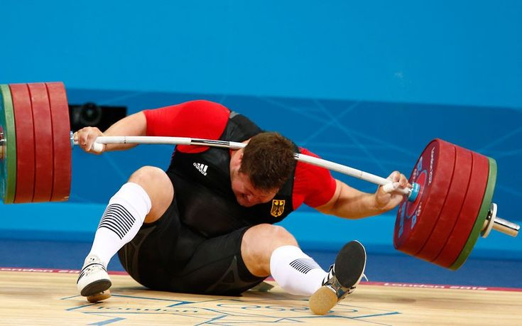 Germany's Matthias Steiner is injured while his weights fall during the men's +105kg Group A snatch weightlifting competition