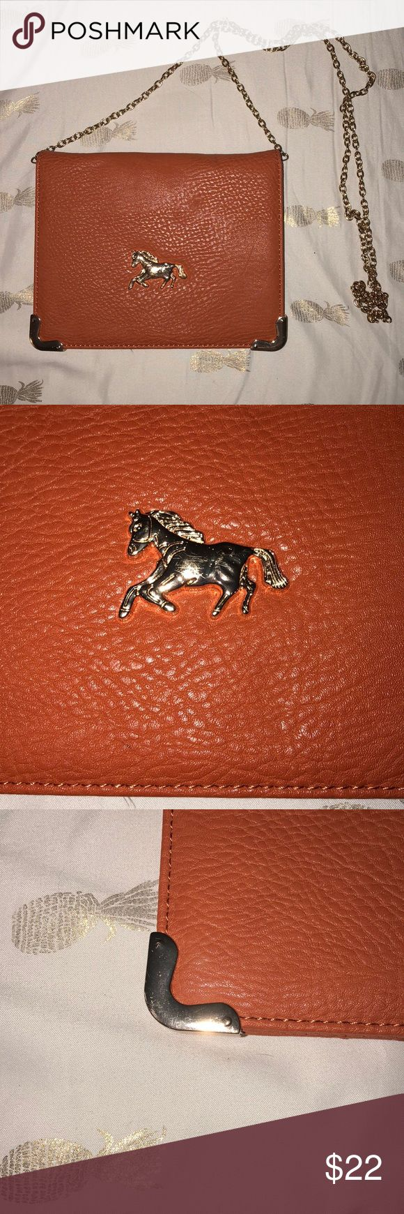 FRANCESCAS Brown Clutch w/ Horse Detail + Chain Beautiful brown/tan clutch with a thin chain strap! Gold Horse Detail on front with minor scratching. Inside of clutch contains multiple pockets, slots, and zippered sections. Minor flaws on front of clutch - like small indents. Not that noticeable. Has only been worn a handful of times. Francesca's Collections Bags Clutches & Wristlets