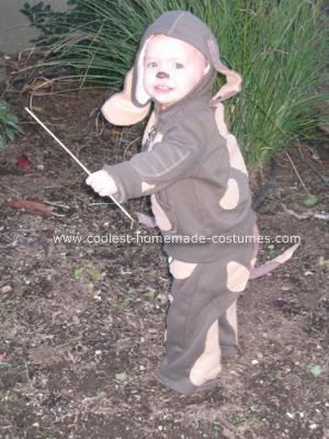 """Dog Costume...""""homemade costume...a brown hooded sweatshirt...hand stitched khaki colored felt...shapes,,,over the sweatshirt and pants. The ears were made of brown and khaki felt The collar was a metal key ring, which I simply wrote her name on in permanent marker, then attached to the zipper."""" Use pipe cleaner to shape ears and tail."""