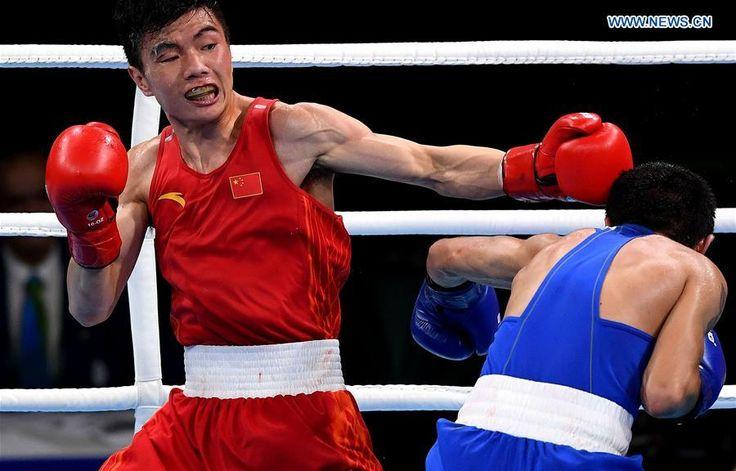 China's Hu Jianguan competes against Armenia's Narek Abgaryan during the men's fly(52KG) preliminary of Boxing at the 2016 Rio Olympic Games in Rio de Janeiro, Brazil, on Aug. 15, 2016. Hu Jianguan defeated Narek Abgaryan. (Xinhua/Lin Yiguang)  http://www.chinasportsbeat.com/2016/08/hu-jianguan-beats-narek-in-mens-fly52kg.html