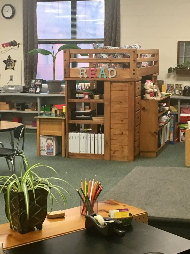 Reading Loft....when you have a small classroom, very little storage and 24 lower elementary Montessori students who have developed a CRAZY love of reading, you get CREATIVE!