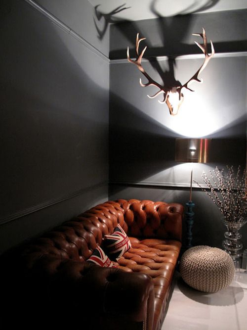 Chesterfield = back | Stylish with dark grey walls and the horns!