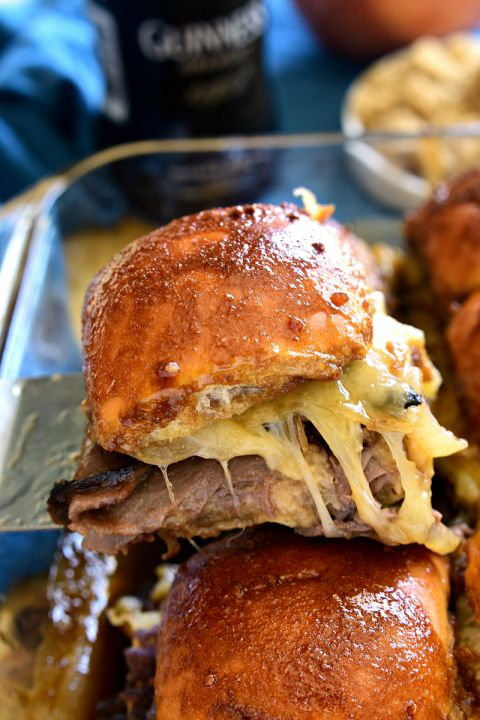 These Guinness Beef Sliders are everything you would want in a sandwich! Delicious butter rolls, layered with roast beef, swiss cheese, mushrooms, and onions, then topped with a rich Guinness glaze and baked to perfection. Perfect for St. Patrick's Day or any day, these sliders are guaranteed to become a favorite!