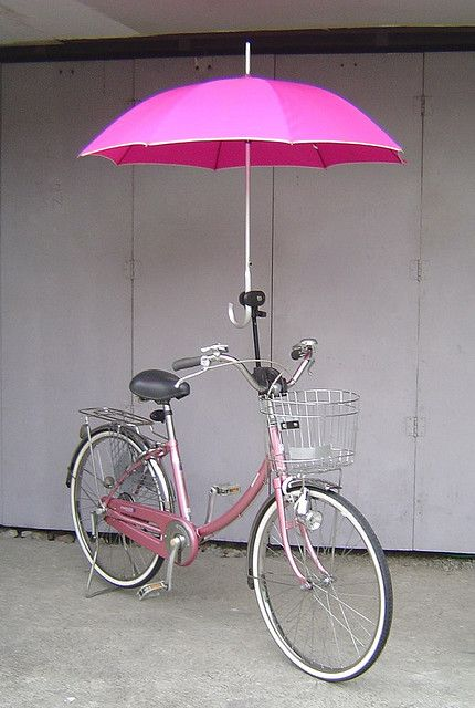 Pink bike....with umbrella. Always be prepared!