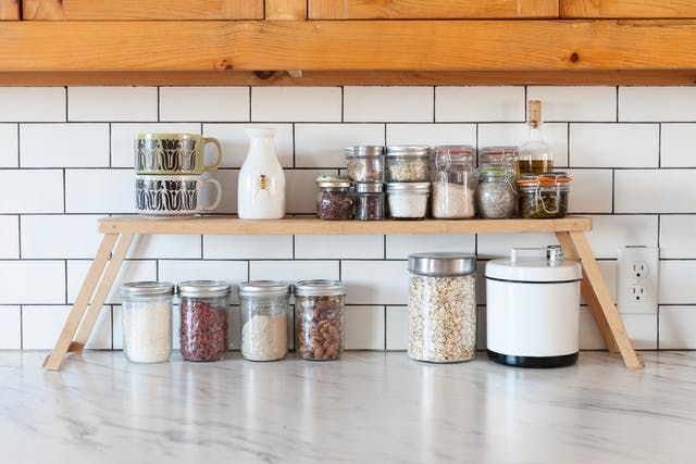 If you have the room to keep your kitchen and bathroom counters clear by tucking tools and objects out of the way in a cabinet or another storage piece, great