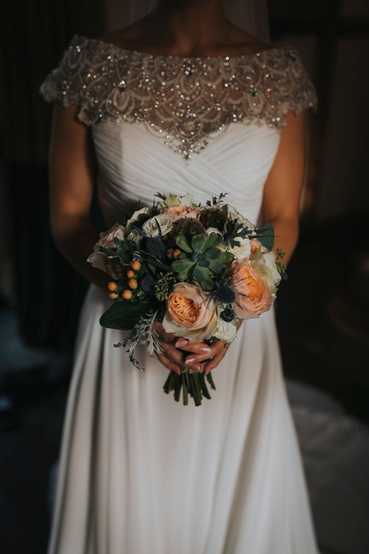 This lovely winter wedding bouquet by @sonningflowers has so many great textures and looks flawless with this bejewelled @justinalexander wedding dress. Photo by Benjamin Stuart Photography #weddingphotography #sonningflowers #justinalexander #weddingflowers #weddingbouquet #weddingdress #bride #winterwedding