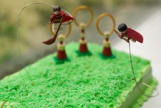 cake with Lego quidditch pieces...looks like coconut dyed green for grass
