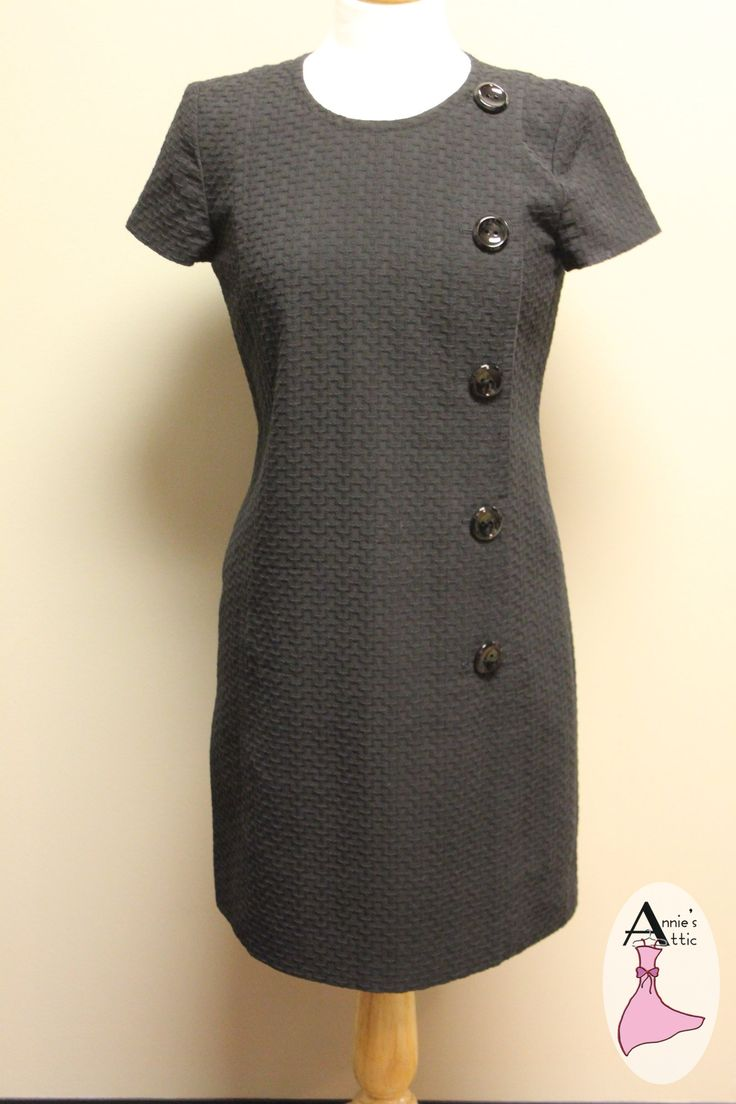 Ann Taylor dress, size 6 Petite Black with 5 large buttons down the front Short sleeves 78% cotton, 22% viscose $29.00