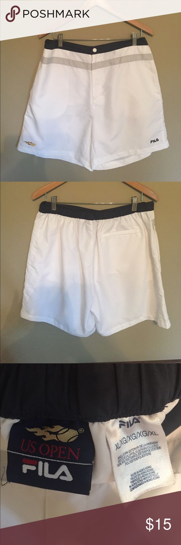 """Fila US Open Men's XL tennis shorts Fila US Open Men's XL tennis shorts. White with grey stripe and navy waistband. Barely worn! 🎾 Great to wear for a """"whites only"""" club Fila Shorts Athletic"""