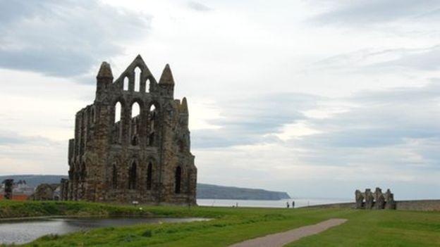 The ruins of Whitby Abbey stand guard over a fishing town popular with visitors and linked to Bram Stoker's novel Dracula