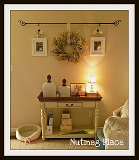 Use a curtain rod to display things...very cute.