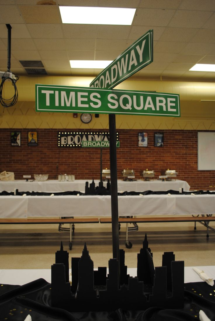 Broadway themed centerpieces made from foam board, printed playbills and inexpensive street signs bought online
