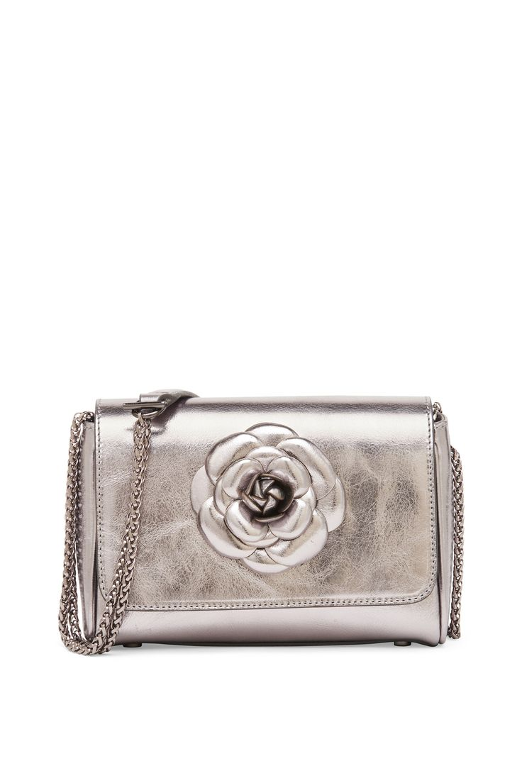 Laminated leather clutch bag with camellia