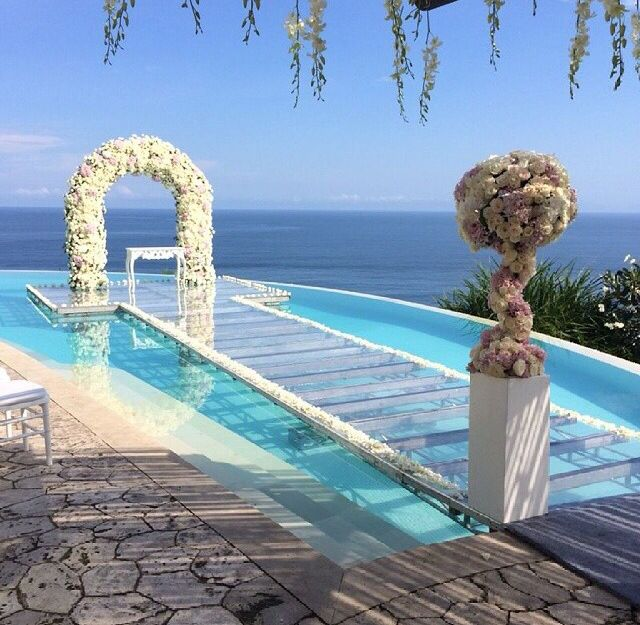 YES Have your ceremony over a pool with this glass top aisle  Looks dreamy  THE LE BLANC